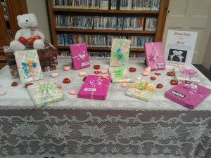 Wrapped books on table for the Blind date with a book display